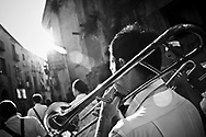 The music band the day befor the Virgin Mary day.In Ponticelli, the eastern outskirts of Naples, for 250 years, the 5th of August is celebrated the Mother of God with the title of &ldquo;Our Lady of the Snows.&rdquo;<br /> The statue of the patron is hoisted on top of the &ldquo;Wagon&rdquo;, the heavy machinery of the party of about 17 meters, carried by hand from less than a hundred men, along the streets of the neighborhood.<br /> The Virgin is enthroned above.<br /> In Via San Rocco the people, without effort, tap the wagon from the balconies, covering it sometimes with confetti.<br /> In Naples, in the places where degradation of culture and traditions are still popular, people condense in the briefest of moments, cyclical, of the party, its history daily, made of sweat, hopes, disappointments, fatigue, illness. The party therefore assumes a character of inevitability for its ability to signify all the painful complexity of life.