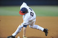 Ole Miss' Sikes Orvis attempts to field a ball vs. Auburn at Oxford-University Stadium in Oxford, Miss. on Friday, April 4, 2014. Mississippi won 8-5.