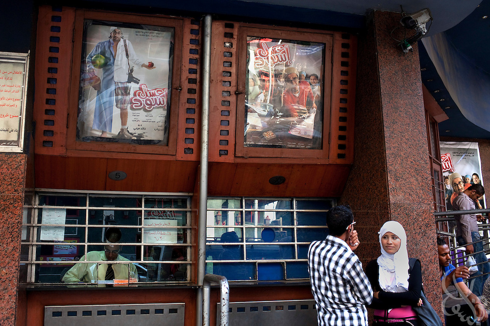 """Egyptian movie fans wait to enter a theater June 15, 2010 to see the recently released film by Egyptian comedy star Ahmed Helmy entitled """"Asal Eswed"""" (literally translated, """"Black Honey"""") in downtown Cairo, Egypt. The film is a social satire that tackles  issues of national identity. (Photo by Scott Nelson for the National)"""