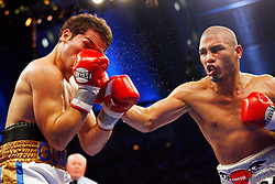 April 12, 2008; Atlantic City, NJ, USA;  Miguel Cotto (Black w/Gray) nails Alfonso Gomez (White, Blue & Gold) with a right hand to the head during their 12 round WBA Welterweight Championship fight at Boardwalk Hall in Atlantic City, NJ.