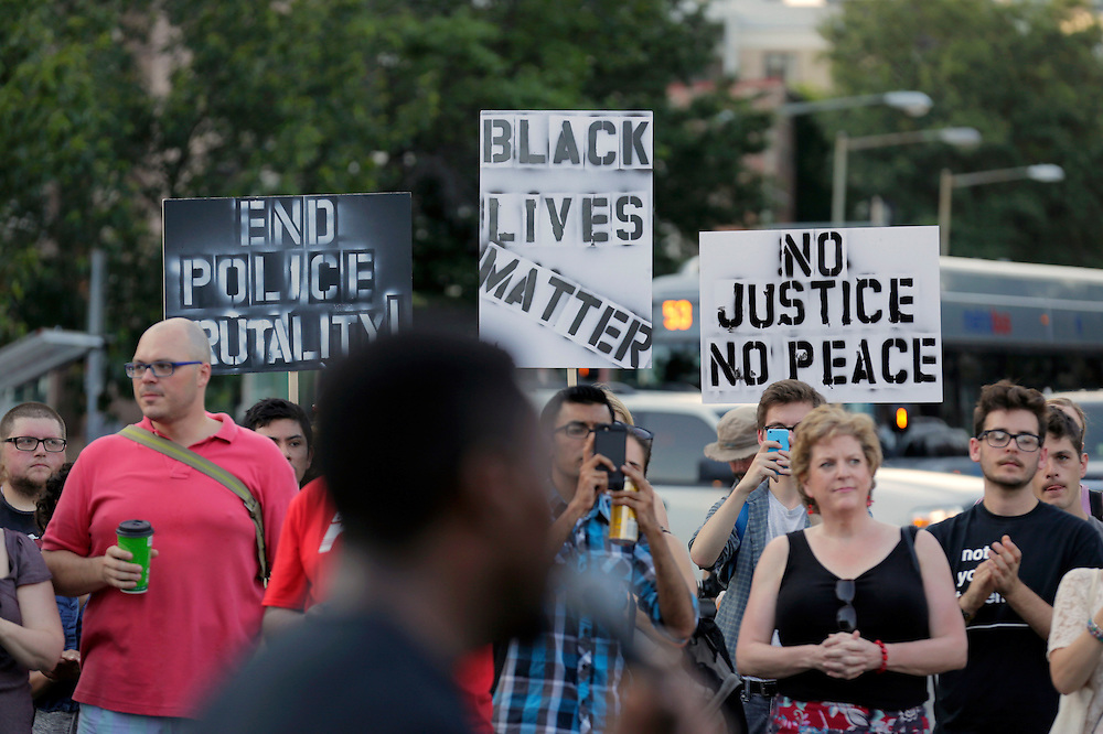 Demonstrators with Black Lives Matter hold up signs before a protest march in Washington, U.S., July 9, 2016.      REUTERS/Joshua Roberts