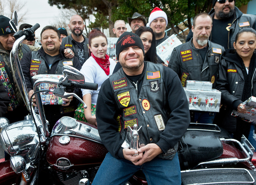 mkb122216/metro/Marla Brose122116<br /> Marty Gagne, front center, is one of the recipients of the Angels Among Us award. Gagne, a member of the motorcycle club Onagers, organizes Duke City Toy Run and other charitable efforts. (Marla Brose/Albuquerque Journal)