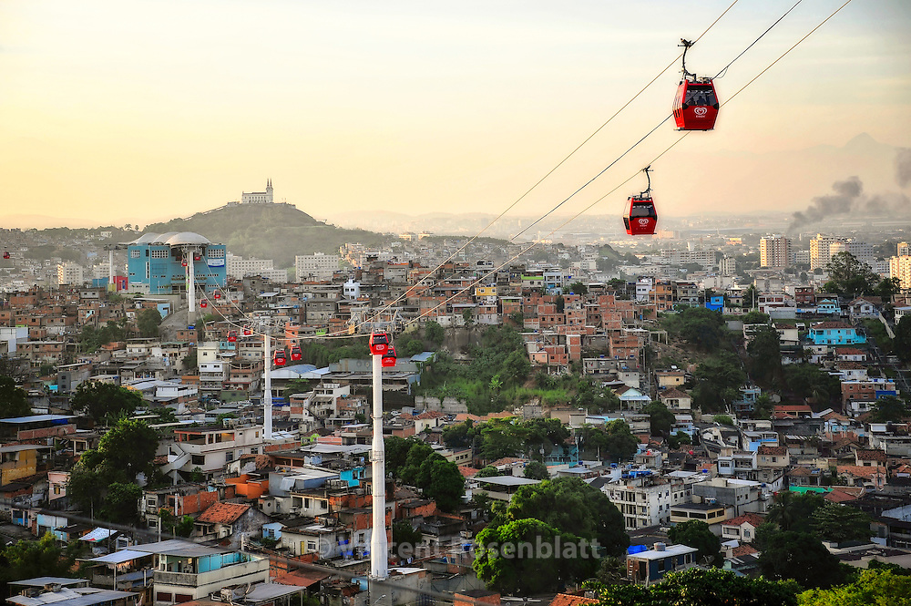 Cable Car connecting all hills and favelas of the Complexo do Alemão. One dollar for the most amazing urban landscapes from Zona Norte of Rio de Janeiro. In the background, the Penha Church.