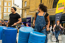 Kings Cross Square, London, July 17th 2015. As part of National Busking Day, Buski in London is launched at King Cross Square with internationally renowned percussion group Stomp and street pop group Tailormade going back to their street performance roots and entertaining the thousands of passing commuters. PICTURED: Internationally famous street percussion group Stomp perform in Kings Cross Square.
