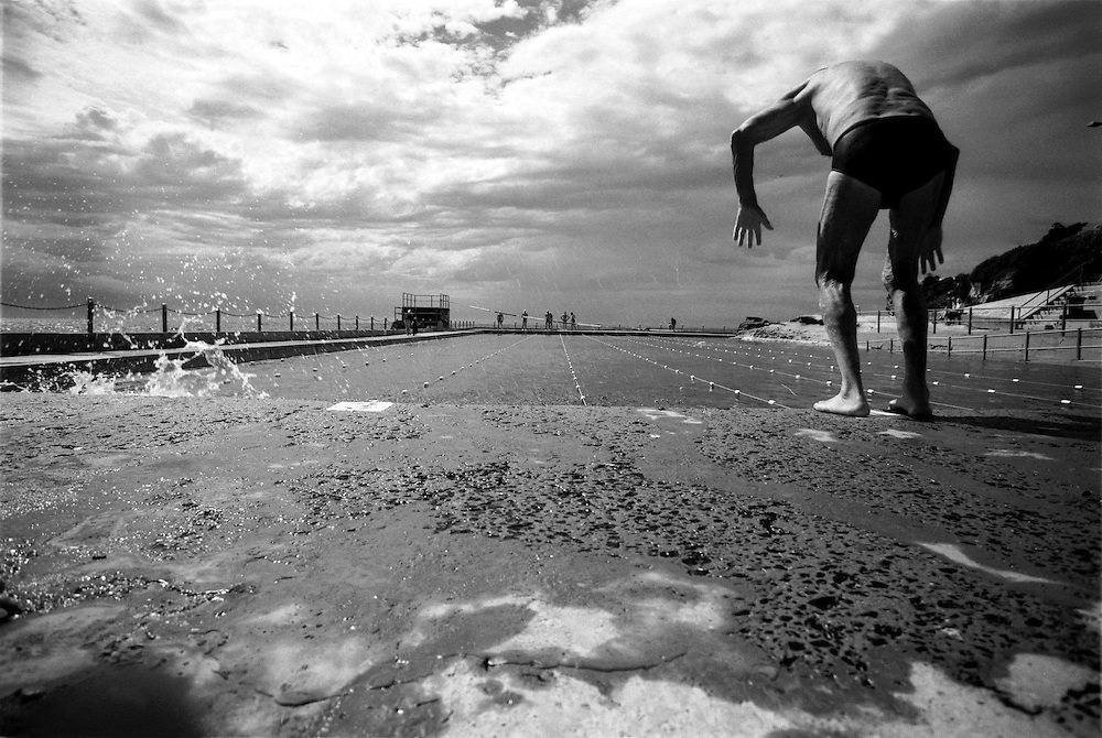 Old man swimming with the Icepicks swimmers in Dee Why outdoor pool. @ Martine Perret