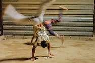 Mentees performing a Capoeira movement in a social project in Esperança Occupancy, Isidoro area.