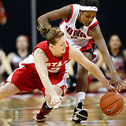 Utah forward Kalee Whipple scrambles for the loose ball with San Diego St. guard Jene Morris as Utah plays against San Diego State in the Mountain West Conference basketball Championship Tournament at the Thomas & Mack Center in Las Vegas, Nevada Saturday, March 13, 2010.  August Miller, Deseret News .