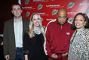 l to r: Chris Brown, Laura Lewis, Rev. Run. and Justine Simmons at The Rush Philanthropic 10th Annual Youth Annual Hoiliday Party sponsored by Bounty and held at the Fillmore New York at irving Plaza on December 10, 2009 in New York City.