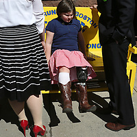 (Boston, MA - 4/15/15) Boston Marathon Bombing survivor Jane Richard sits on a bench in front of the Boylston Street Fire Station, Wednesday, April 15, 2015. Staff photo by Angela Rowlings.