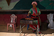 A woman cooks a chichens entrails, in Doi Ang Khang moutains, Thailand. PHOTO TIAGO MIRANDA