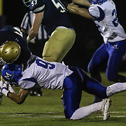 Salesianum wide receiver Jeremy Ryan (5) catches the ball as Middletown defensive back Shane<br /> Wilkins (9) makes the tackle in the second quarter Friday, Oct. 09, 2015 at Bernard Stadium in Wilmington, DE.