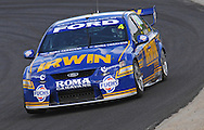 Alex Davidson driver of the #4 Stone Brothers Racing Irwin Tools sponsored V8 Supercar. New race livery for the 2011 season. Ride day at Calder Park Raceway.<br /> 16th December 2010<br /> (C) Joel Strickland Photographics.Use information: This image is intended for Editorial use only (e.g. news or commentary, print or electronic). Any commercial or promotional use requires additional clearance.