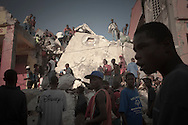 Port-Au-Prince, Haiti, January 17 of 2010:  Victims of the 2010 Haitian earthquake struggle to survive in Port-au-Prince. More than 316.000 people were killed in this disaster. Photo: Caio Guatelli.
