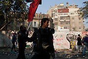 Egyptian protesters taunt nearby security forces during clashes November 22, 2011 near Tahrir square in central Cairo, Egypt. Thousands of protestors demanding the military cede power to a civilian government authority clashed with Egyptian security forces for a fourth straight day in Cairo, with hundreds injured and at least 29 protestors killed so far.  (Photo by Scott Nelson)