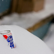 """SHOT 1/12/09 1:59:49 PM - A Pabst Blue Ribbon beer can chilling in a snow bank in Crested Butte, Co. Crested Butte is a Home Rule Municipality in Gunnison County, Colorado, United States. A former coal mining town now called """"the last great Colorado ski town"""", Crested Butte is a destination for skiing, mountain biking, and a variety of other outdoor activities. The population was 1,529 at the 2000 census. The Colorado General Assembly has designated Crested Butte the wildflower capital of Colorado. The primary winter activity in Crested Butte is skiing or snowboarding at nearby Crested Butte Mountain Resort in Mount Crested Butte, Colorado. Backcountry skiing in the surrounding mountains is some of the best in Colorado. The mountain, Crested Butte, rises to 12,162 feet (3,700 m) above sea level..(Photo by Marc Piscotty / © 2009)"""