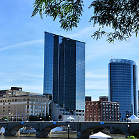 Downtown Grand Rapids and Grand River in Grand Rapids, Michigan<br /> The Grand Rapids&rsquo; skyline on the east bank of the Grand River is dominated by the Amway Grand Plaza Hotel (left) and the JW Marriott Grand Rapids (right). They are the city&rsquo;s third and sixth tallest buildings.  The city has a population of nearly 190,000 people. Among its native sons is former President Gerald Ford. Grand Rapids is nicknamed &ldquo;Furniture City&rdquo; for its historic lumbering and furniture manufacturing.