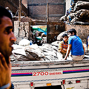 """The so-called """"Garbage city"""" or Muqattam, on a hill overlooking Cairo city. This part of Cairo is inhabited by mainly Christians. Extremely poor, all people here they try to survive as garbage collectors. They separate the garbage which is then sold to be recycled"""