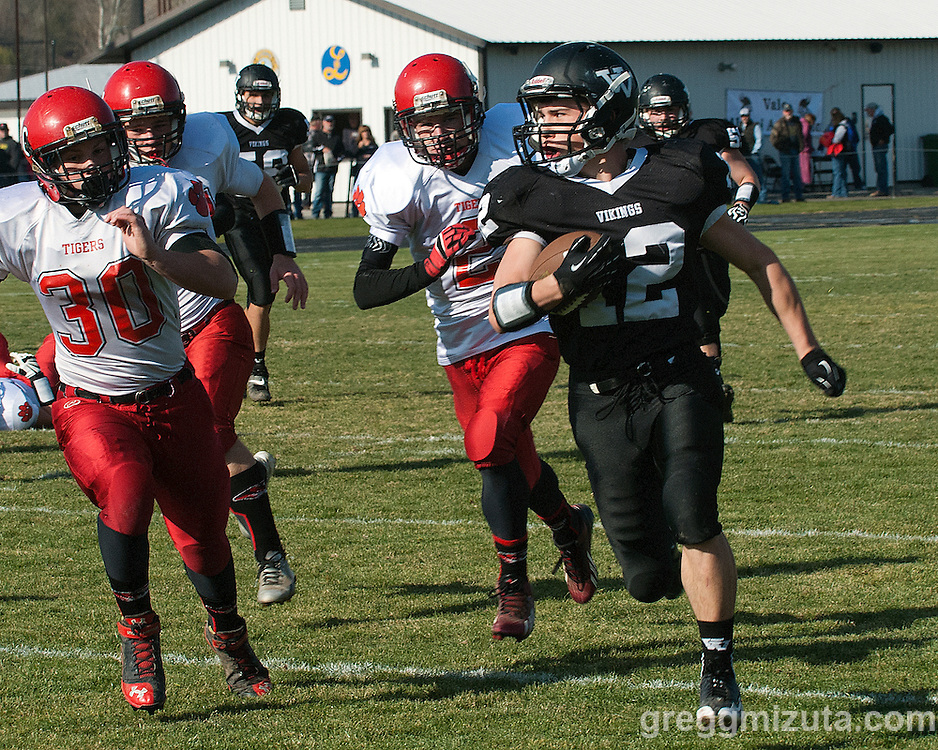 Vale sophomore Zac Jacobs is pursued by Clatskanie's  Micah McLeod and Colton Puzey in the first quarter of the round 1 playoff game, November 9, 2013 at Frank Hawley Stadium Vale High School, Vale, Oregon. Vale won 46-0.