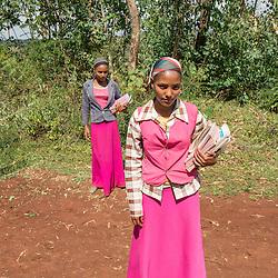 Kamila Khader and Shimla Mangastu walk to school next to the coffee plantation Welinsu in Limu, Ethiopia.