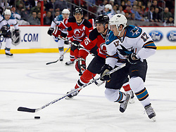 February 20, 2008; Newark, NJ, USA;  San Jose Sharks center Torrey Mitchell (17) skates by New Jersey Devils right wing Jamie Langenbrunner (15) during the first period at the Prudential Center in Newark, NJ.