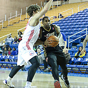 Erie BayHawks Guard Chris Smith (0) drives towards the basket as Delaware 87ers Guard Matthew Bouldin (23) defends in the second half of a NBA D-league regular season basketball game between the Delaware 87ers (76ers) and the Erie BayHawks (Knicks) Tuesday, Feb. 11, 2014 at The Bob Carpenter Sports Convocation Center, Newark, DE