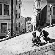Children street sledding down steep hill, North Beach, San Francisco, 1952