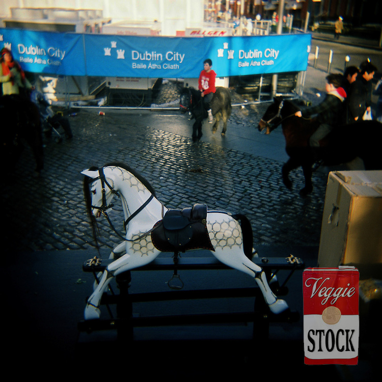 A rocking horse with horse sellers at Smithfield Horse Market, Dublin, Ireland, November 2008.