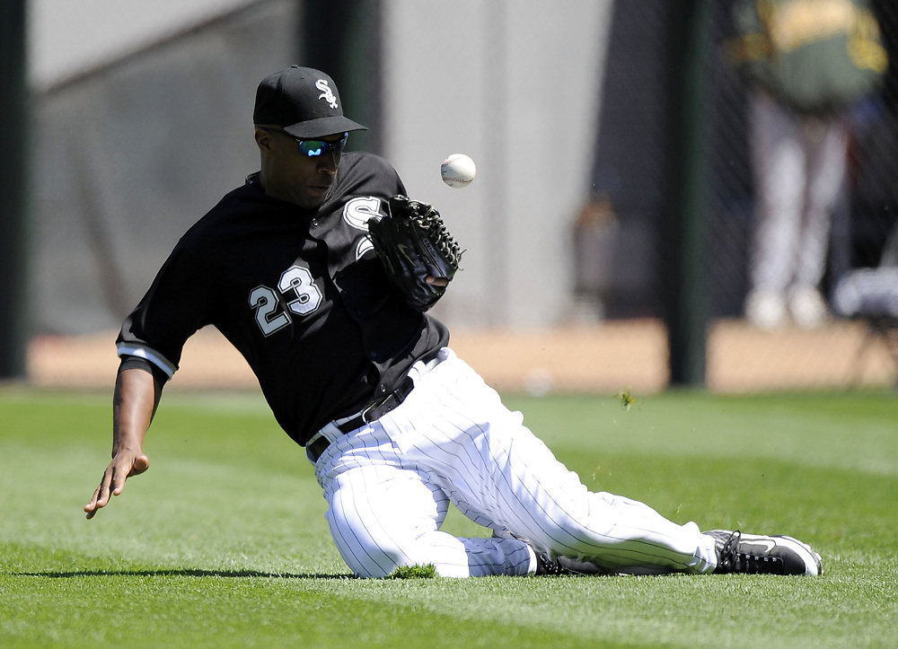 CHICAGO - JUNE 04:  Jermaine Dye #23 of the Chicago White Sox dives but cannot make the catch on Gregorio Petit #2 of the Oakland Athletics fly ball on June 4, 2009 at U.S. Cellular Field in Chicago, Illinois.  Dye was charged with an error on the play.  The Athletics defeated the White Sox 7-0.  (Photo by Ron Vesely)