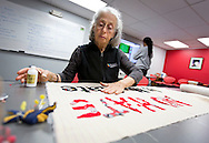 MADISON, WI – MARCH 27: Mary Sanderson designs a protest sign at the UW South Madison Partnership space in advance of Presidential candidate Donald Trump's visit to Janesville, Wisconsin.