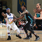 Delaware 87ers Guard NATE ROBINSON (1) passes the ball as Greensboro Swarm Guard MARDRACUS WADE (5) defends in the second half of an NBA D-league regular season game between the Delaware 87ers and the Greensboro Swarm (Charlotte Hornets) Wednesday, March 29, 2017, at The Bob Carpenter Sports Convocation Center in Newark, DEL