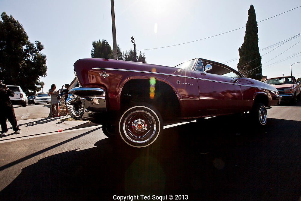 A red lowrider rolls by on 3 wheels outside the church.<br />  Funeral services for Kevin &quot;Flipside&quot; White at Macedonia Church in Watts.<br /> White was shot dead in what is believed to be an unprovoked attack during a gang conflict at Watts' Nickerson Gardens and Jordan Downs housing projects.<br /> Flipside, 44, was a founding member of Watts' first major label hip hop act, O.F.T.B. (Operation From The Bottom).