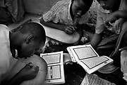 Mauritanian children copy Koranic verses in Arabic on small wooden tablets at an Islamic mosque madrassa (school) in the poor Bohdida district of the Mauritanian Capital Noukchott May 20, 2008. Dozens of students spend several hours a day at small madrassas like this across Mauritania, meticulously copying passages of the Koran again and again on their small wooden tablets.