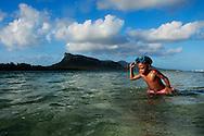 Young Ni Vanuatu boy looking for fish with a spear. Rah Lava Island, Torba Province, Vanuatu