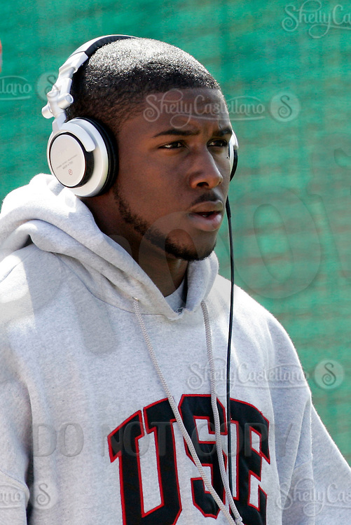 2 April 2006: Heisman winner Reggie Bush listening to Sony Music arrives at pro-day timing workout by pro football teams at NFL pro-timing day at USC college campus in Los Angeles, CA.