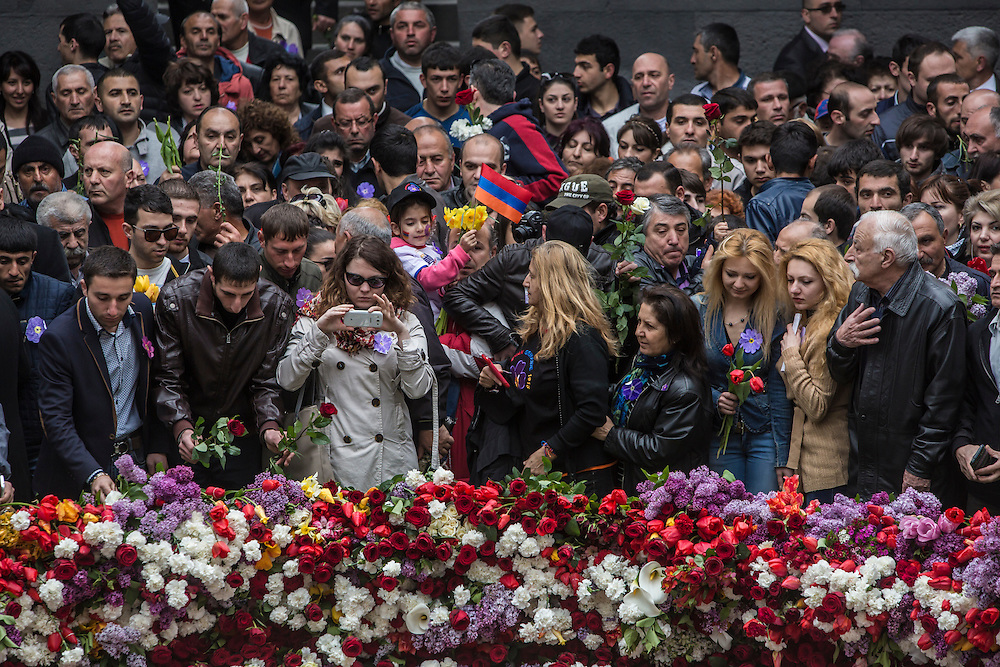 YEREVAN, ARMENIA - APRIL 24: Thousands of people visit the Armenian genocide memorial to lay flowers at the eternal flame on April 24, 2015 in Yerevan, Armenia. Armenians today are marking the one hundredth anniversary of events generally considered to be the start of a campaign of genocide against minority ethnic Armenians living in present-day eastern Turkey by the Ottoman government over fears of their allegiance during World War I. (Photo by Brendan Hoffman/Getty Images) *** Local Caption ***