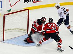 Nov 9, 2008; Newark, NJ, USA; Edmonton Oilers' Ales Hemsky (83)  scores a goal against New Jersey Devils goalie Scott Clemmensen (35) during the second period at the Prudential Center.