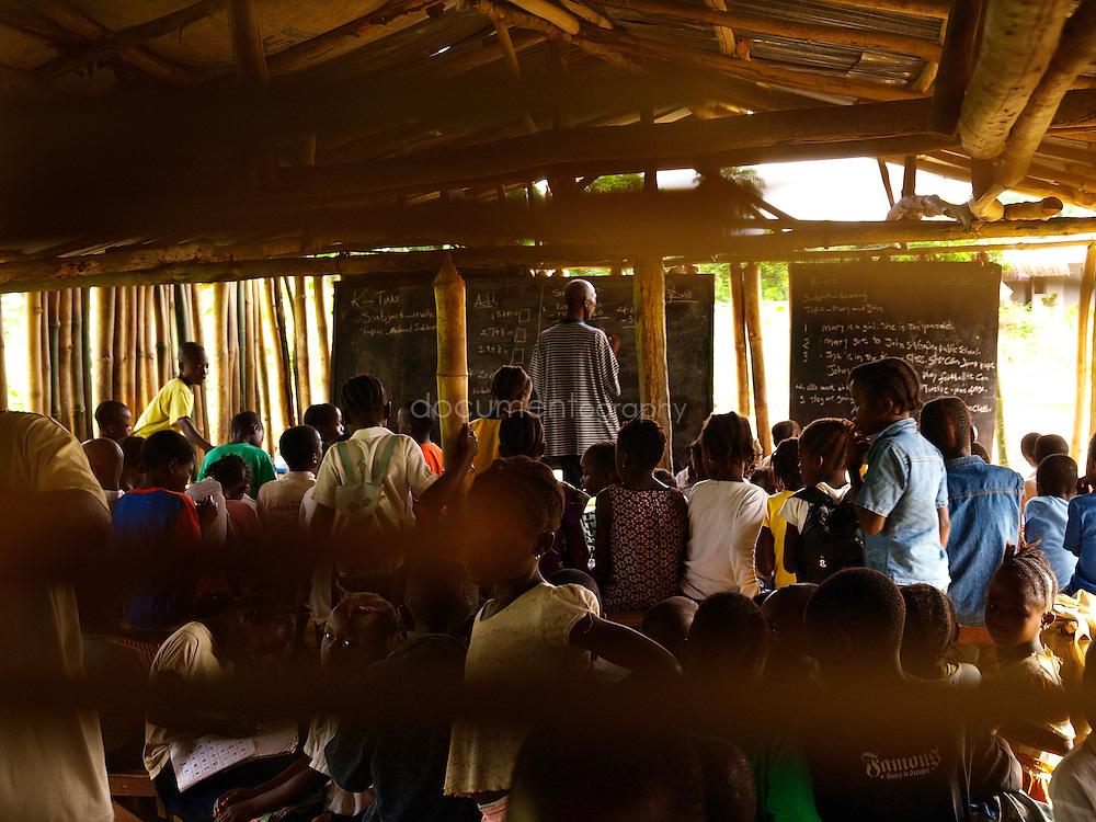 Pupils and teacher at J.S. Varfley School, Kingsville #7, Liberia.