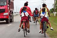 Bicycling home from school in Moron, Ciego de Avila, Cuba.