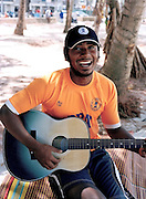 Life guard strumming his guitar on Patong Beach