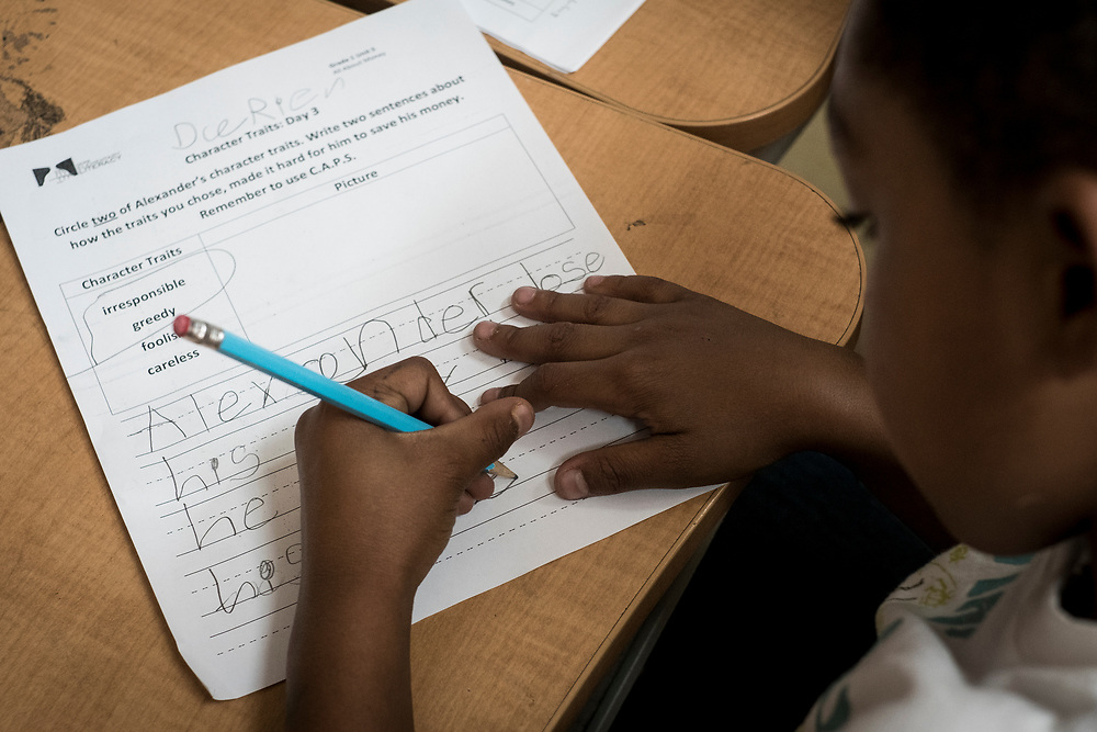 A student completes a lesson at Turner Elementary School in Washington, D.C.,  on Wednesday, May 4, 2017.