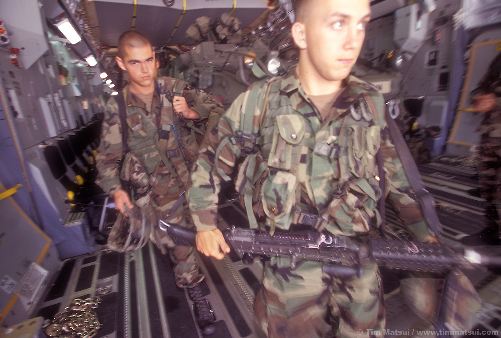 Members of Alphan Company, 5th Battalion, 20th Infantry from Ft. Lewis, Wash., unload from an Air Force C-17 near the National Training Center in Ft. Irwin, Calif. on Friday, July 26, 2002. With them are two of 14 Strykers, the medium weight armored vehicles now integral to their unit. The army has only had the Stryker for a month and this is their debut in maneuvers at 'war' at Ft. Irwin for the Millennium Challenge 2002 Experiment (MCO2)...The Stryker has a communictions package, called the FBCB2 that enables them to transmit and receive data on their position, the position of other FBCB2 equiped vehicles, still shots from unmanned aerial vehicles, and data from higher command. This will help improve their intelligence knowledge and share in real time with other units...As part of the military transformation MC02 is testing all branches of the military in the largest ever live and virtual battle being played out across the nation through August 15, 2002. The goal is to see how well the different branches operate together under a joint command that shares intelligence and resources in an effort to put the right forces in the right place at the right so as to minimze the amount of fighting that is necessary to protect U.S. interests abroad.
