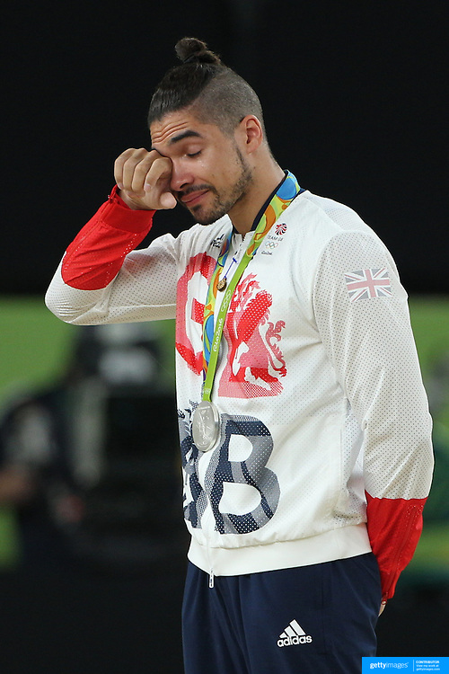 Gymnastics - Olympics: Day 9 Louis Smith of Great Britain, in tears on the podium after winning the silver medal in the Men's Pommel Horse Final at the Rio Olympic Arena on August 14, 2016 in Rio de Janeiro, Brazil. (Photo by Tim Clayton/Corbis via Getty Images)