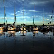 Sailboats catch the warm glow of early evening at the Red Rock marina last summer.  photo by david peterson