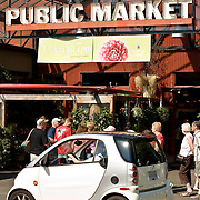 A Smart Car in front of  the Public Market on Granville Island, Vancouver British Columbia, Canada
