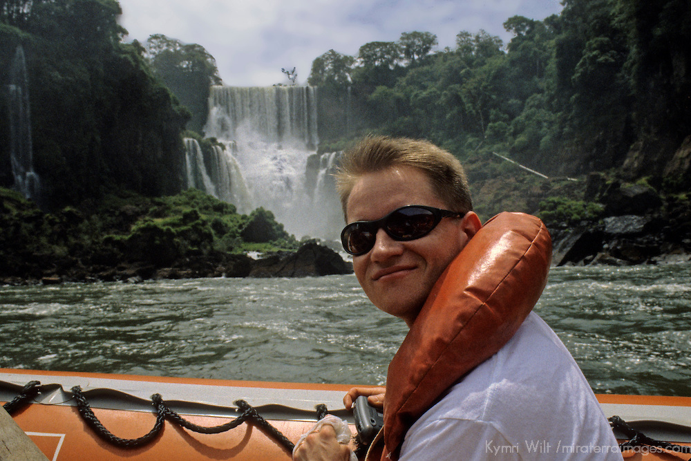 South America, Argentina, Iguacu Falls. Tourist on boat excursion at base of Iguacu Falls.