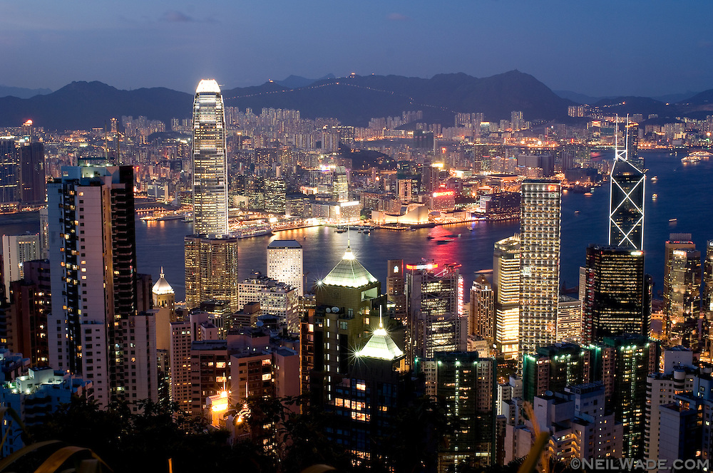 The Hong Kong city skyline with Hong Kong Harbor and Kowloon in the background as seen from Victoria Peak.