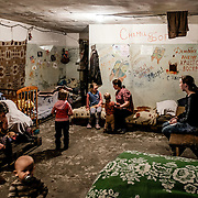 12 of April 2015 / Petrovski/ Donetsk Oblast/ Ukraine - Typical room for a family in the bunker. Here 7 people sleep and live in this room. The grandmother on the left, the mother and her five kids. The father has gone, no clear explanation from the mother.