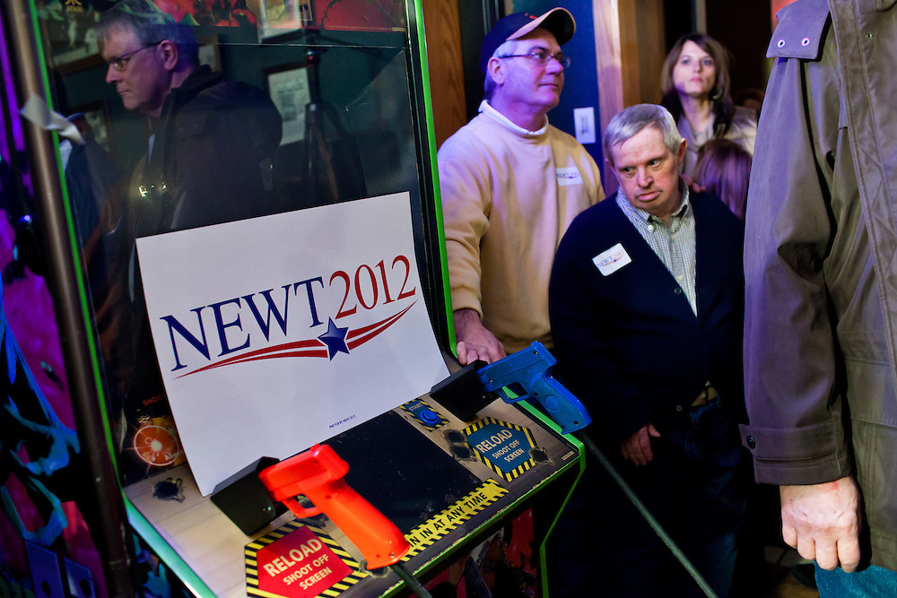 A sign for Republican presidential candidate Newt Gingrich sits on top of an arcade game at LJ's Neighborhood Bar & Grill on Sunday, January 1, 2012 in Waterloo, IA.
