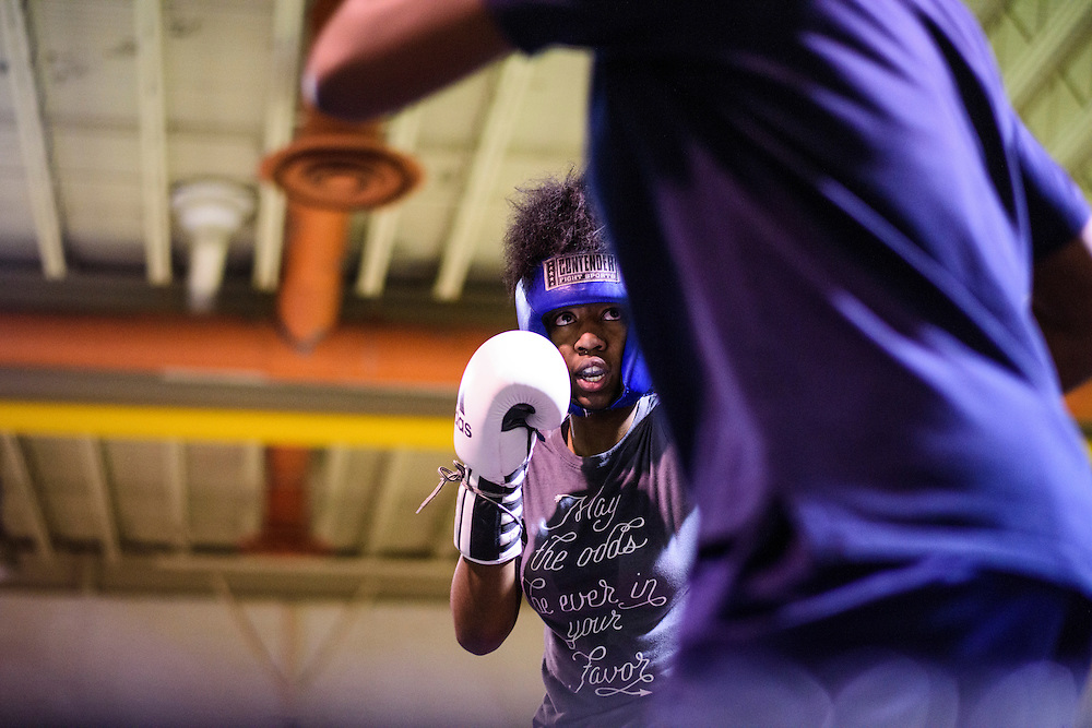iBaltimore, Maryland - January 26, 2017: Mia &quot;Killer Bee&quot; Ellis, 16, left, spars with Aiyahnah &ldquo;Stringbean The Dream Killa&rdquo; Burke, 15, (foreground) at the Upton Boxing Club in Baltimore. Coach Calvin Ford watches in the middle.<br /> <br /> <br /> CREDIT: Matt Roth for The New York Times<br /> Assignment ID: