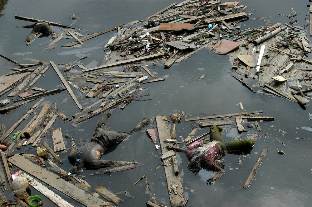 The bodies of victims of the Tsunami that claimed the lives of well over a hundred thousand people lie beside a bridge in Banda Aceh January 2005
